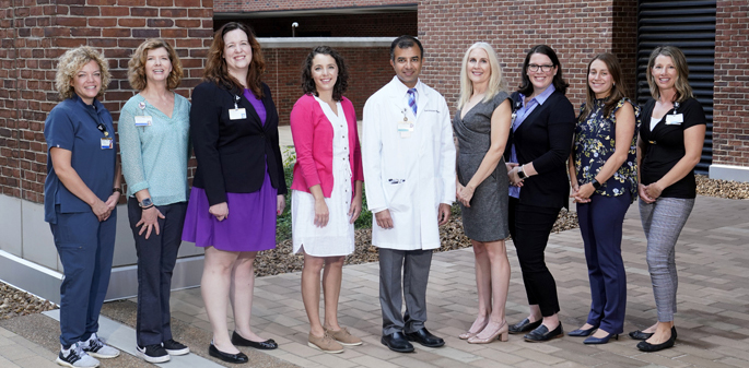 VUMC members of the Quality Improvement Collaborative for COVID-19 Prevention and Control in Middle Tennessee Nursing Homes are, from left, Monique George, RN, FNP, Carole Bartoo, MSN, AGNP-BC, Jacy Weems, Mattie Brady, MSN, Sunil Kripalani, MD, MSc, Sandra Simmons, PhD, Anna Gallion, DNP, APRN, Tara Horr, MD, and April Hanlotxomphou, MSN, FNP. Not pictured are Victor Legner, MD, MS, and Kristina Niehoff, PharmD. (Photo taken by Donn Jones prior to revised mask guidelines)