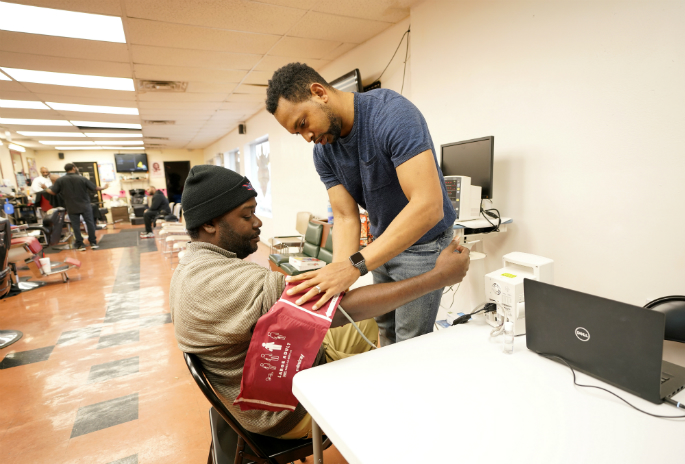 Jarod Parrish, PharmD, the study's pharmacist, will check patrons' blood pressure inside eight Nashville barbershops to identify those who have uncontrolled hypertension.