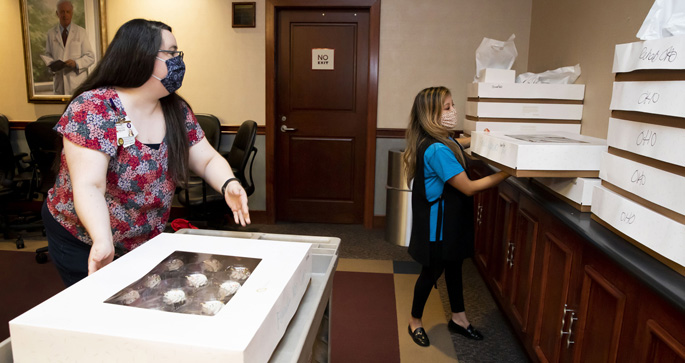 Angela Presti, left, and Erin Rothwell help distribute 3,000 cupcakes as part of celebrations for Monroe Carell Jr. Children's Hospital at Vanderbilt's strong showing in U.S. News & World Report's ranking of America's Best Children's Hospitals.