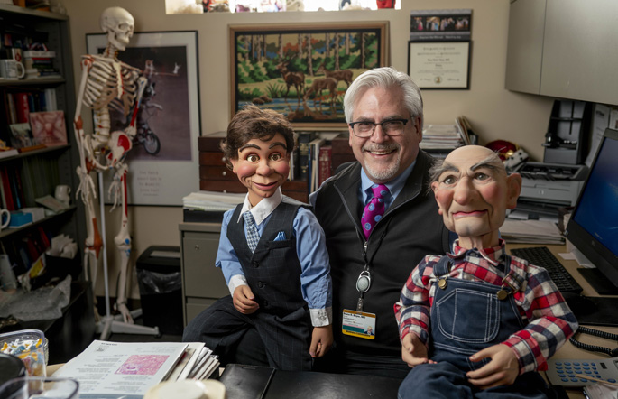 Obstetrician Bruce Beyer, MD, began collecting and learning how to perform with ventriloquist figures while a medical student.