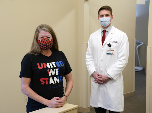 Patient Michelle O'Donnell poses with Eric Bowman, MD, during a follow-up appointment at the Vanderbilt Orthopaedic Injury Clinic held at Vanderbilt Orthopaedics Franklin.