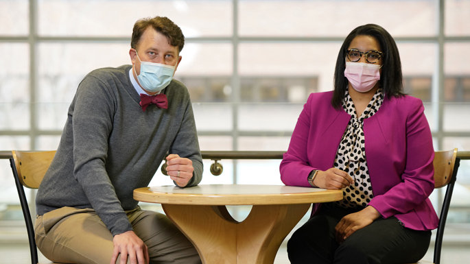 Danielle Buchanan, BS, right, and Daniel Claassen, MD, MS, are studying the relationship between clinical research coordinators principal investigators. (photo by Donn Jones)