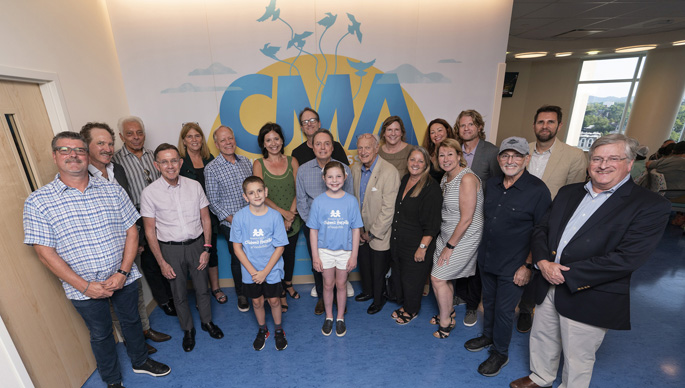 Monroe Carell Jr. Children's Hospital at Vanderbilt patients Cooper Cook (center, left) and Grace Hamilton (right) give CMA and CMA Foundation board members a tour of CMA's newly named space within the hospital's expansion.