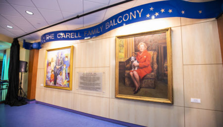 Portraits of Monroe Carell Jr. and Ann Scott Carell highlight the new Carell Family Balcony.