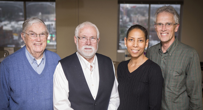 Anderson Spickard Jr., MD, left, William Swiggart, MS, Charlene Dewey, MD, MEd, and Ron Neufeld, BSW, LADAC, stand on the 11th floor of the Oxford House, where the Center for Professional Health was launched in 1987.