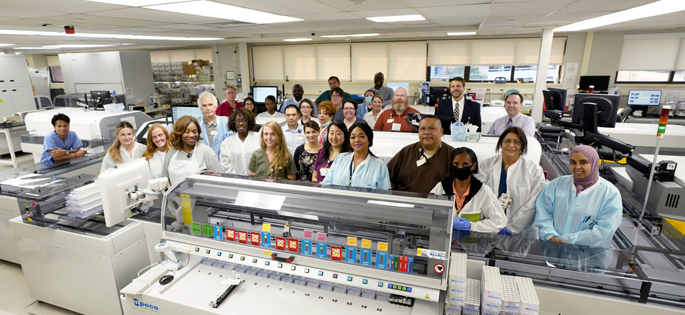 Core Clinical Chemistry Lab staff members gathered recently to mark the launch of a faster, higher-volume automated chemistry line.