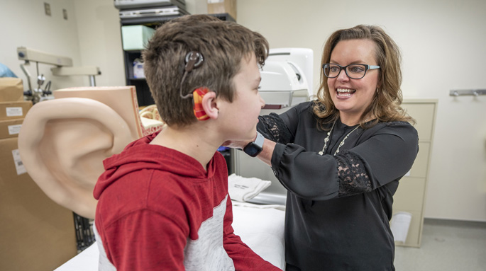 Rene Gifford, PhD, works with patient Davy Hillis to program his cochlear implant.