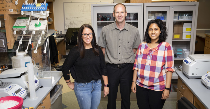 Madison Adolph, PhD, left, David Cortez, PhD, and Archana Krishnamoorthy are studying fundamental processes involved in DNA replication.