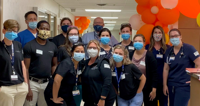 "The ""orange team,"" led by Buddy Creech, MD, director of the Vanderbilt Vaccine Research Program, assembles in the old Clinical Research Center space in Medical Center North on the first day of the phase 3 Moderna vaccine study this summer."