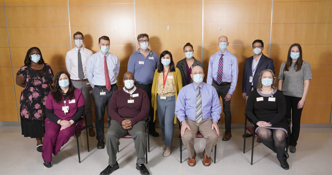 The study team includes (seated, from left) Adrienne Baughman, CCRP; Bob McClellan; Wesley Self, MD, MPH; Christina Kampe, CCRP; (standing, from left) Rendie McHenry; Bo Stubblefield, MD; Jon Casey, MD, MSCI; Todd Rice, MD, MSc; Natasha Halasa, MD, MPH; Jakea Johnson, MPH; Jim Chappell, MD, PhD; Carlos Grijalva, MD, MPH; and Kelsey Womack, PhD. Not pictured are Julia Rhoads, PhD; Chris Lindsell, PhD; Keipp Talbot; MD, MPH; and Kimberly Hart, MA. (photo by Donn Jones)