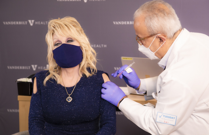 Country music icon Dolly Parton received her COVID-19 vaccination at Vanderbilt Health Tuesday, March2, from Naji Abumrad, MD, and urged everyone not to hesitate to get their vaccine when they become eligible to receive it.