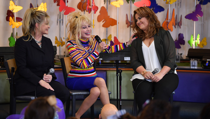 Following the Hannah Dennison Butterfly Garden dedication at Monroe Carell Jr. Children's Hospital at Vanderbilt, Dolly Parton and her niece, Hannah, visit with patients in Seacrest Studios. (photo by John Russell)