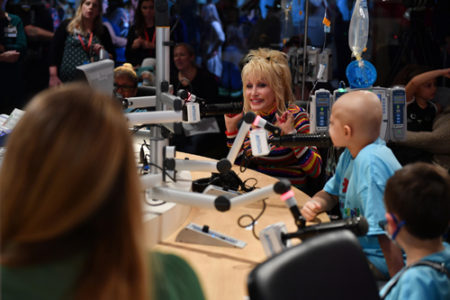 During her visit to Monroe Carell Jr. Children's Hospital at Vanderbilt, country music legend Dolly Parton took part in an on-air interview at Seacrest Studios that was simulcast to four other children's hospitals in the United States. (photo by Jason Davis/Getty Images)