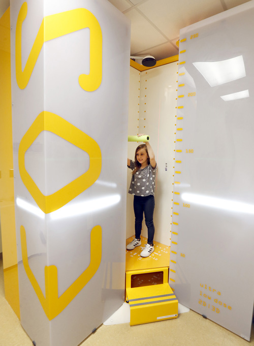 Chloie Jacobs demonstrates the new X-ray imaging device at Monroe Carell Jr. Children's Hospital at Vanderbilt that uses ultra-low radiation doses.