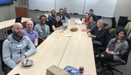 Members of the LGBTQ Employee Resource Group (also known as P.R.I.D.E.) enjoyed a lunchtime social in February 2020, before the pandemic and physical distancing.