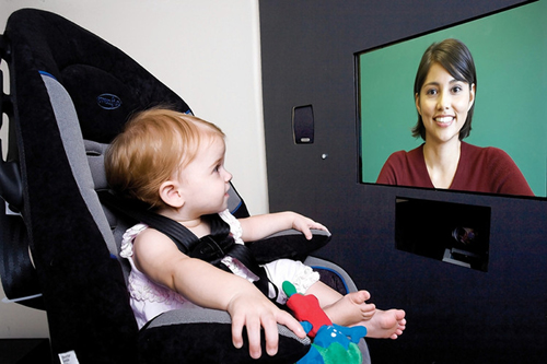 A study participant at Emory University School of Medicine watches a video while an eye tracker records when and where she looks at the screen.