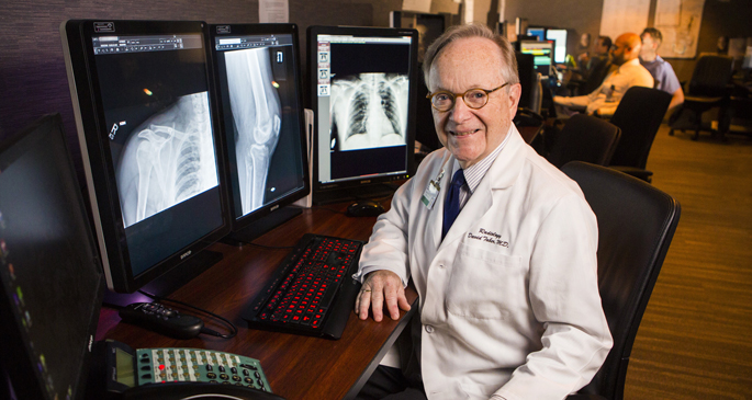 David Taber, MD, spends most of his clinical time in the radiology reading room, working with residents and students and interpreting images.