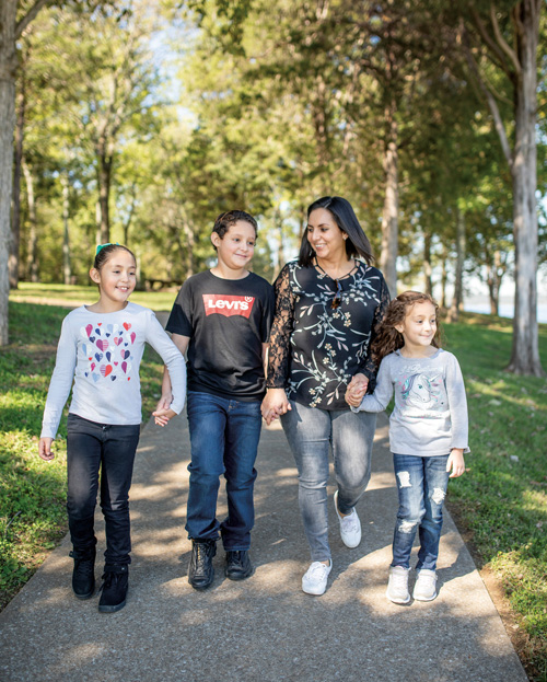 Gloria Guzman Jimenez and her children, Sophia Sapulveda, 8, left, Eduardo Sapulveda, 10, and Andrea Sapulveda, 6, participated in the GROW trial on pediatric obesity.
