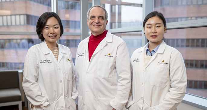 A new grant is helping Eunyoung Choi, PhD, left, James Goldenring, MD, PhD, Jimin Min, PhD, and colleagues around the globe to study inflammation-related cancers.