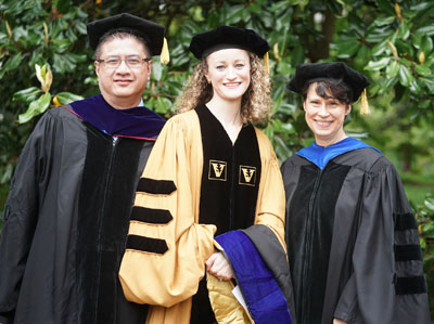 Christi Salisbury-Ruf, center, earned her PhD in Cell and Developmental Biology, working with collaborator Eric Gamazon, PhD, and mentor Sandra Zinkel, MD, PhD.