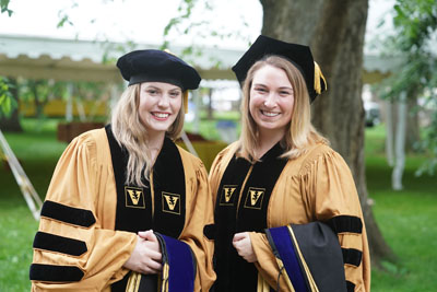 Graduate School students Nicole Perry-Hauser, left, and Kristin Peterson earned PhD degrees in Pharmacology.