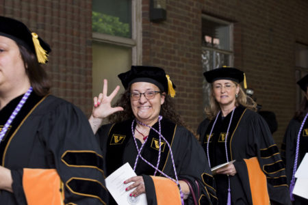 VUSN DNP graduates Danica Ninkovic, left, and Olive Phillips make their way to the main ceremony.