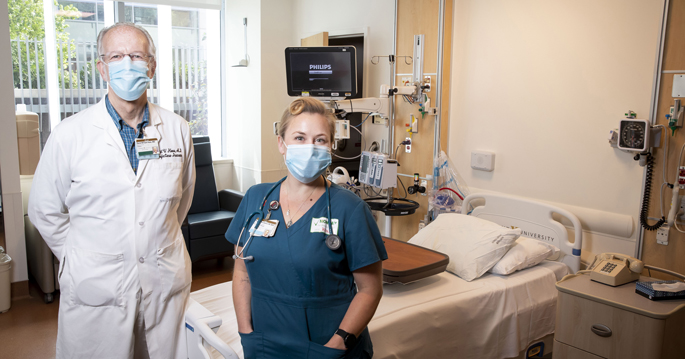 David Haas, MD, and Beverly Woodward, MSN, RN, are shown in a procedure room in VUMC's Communicable Disease Response Unit. The room contains state-of-the-art infection prevention features and opens directly to the outside.
