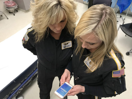 LifeFlight's Michelle Brazil, RN, EMT, left, and Jill Hazelwood, CCP, work with the Haiku app to view patients' medical records.