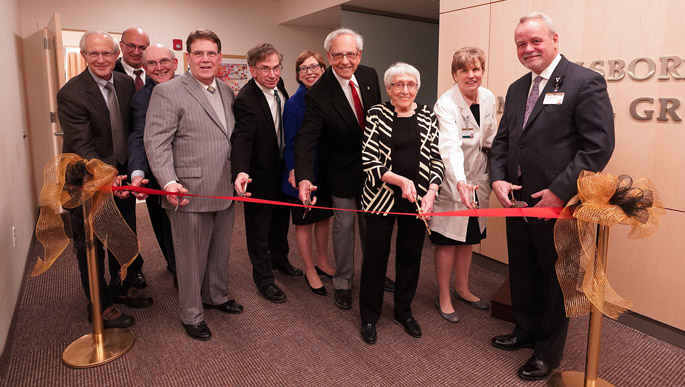 VUMC leaders and clinic representatives cut the ribbon at the new location of the Hillsboro Medical Group. Those participating were, from left, James Powers, MD, Tom Elasy, MD, MPH, Craig Sussman, MD, C. Wright Pinson, MBA, MD, Robert Miller, MD, Marilyn Dubree, MSN, RN, Paul Barnett, MD, clinic founding partner, Irma Kaplan, wife of clinic founding partner Herman Kaplan, MD, Nancy Brown, MD, and Tom Nantais, MBA.