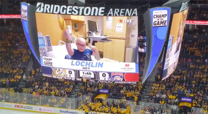 Monroe Carell Jr. Children's Hospital at Vanderbilt patient Lochlin Morris is shown here being featured on the jumbotron at a Nashville Predators game in October 2019, prior to social distancing.