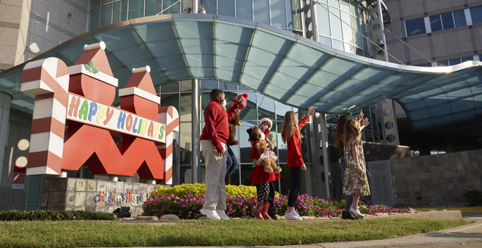 Monroe Carell Jr. Children's Hospital at Vanderbilt patient ambassadors get in the holiday spirit as they wave to the camera for the filming of the Nashville Holiday Music Special outside Children's Hospital.