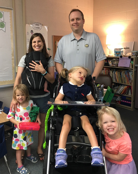 At the annual flag-raising ceremony on April 16, the Honeycutt family will share the story of their daughter, Mikayla, center, whose organs were donated following her death in September. From left are Heather with Caroline (in the baby carrier), Ainsley, Graham and Hailey.