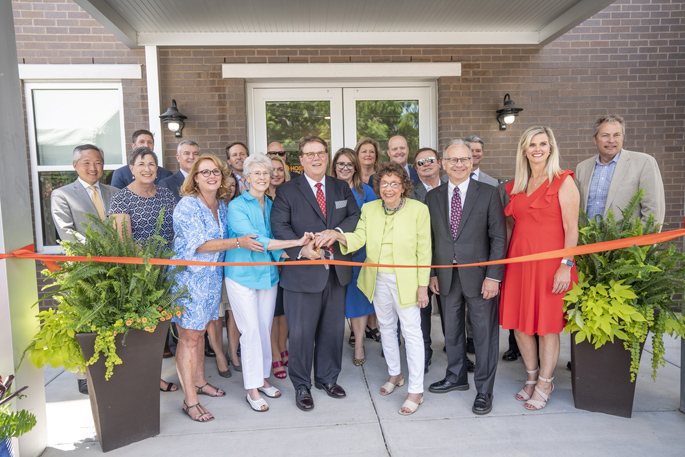"Supporters cut the ribbon last week to celebrate the newly expanded and renamed Pinson Hospital Hospitality House, which provides lodging for families and long-term patients at Nashville-area hospitals. Front row, from left are Board Chair Lisa Slipkovich, Ann Krenson, board member C. Wright Pinson, MBA, MD, Mickey Beazley, Metro Mayor David Briley and Hospitality House Executive Director Angie Stiff. Beazley and Krenson led efforts to open the original facility in 1974. Currently located at 214 Reidhurst Ave., it was renamed at the request of philanthropists Jim and Janet Ayers (not pictured), major contributors to the renovation. ""We are thrilled that the Pinson Hospital Hospitality House will be able to now accommodate even more families that are impacted by extended illnesses and injuries and have the added burden of finding affordable lodging,"" said Janet Ayers."