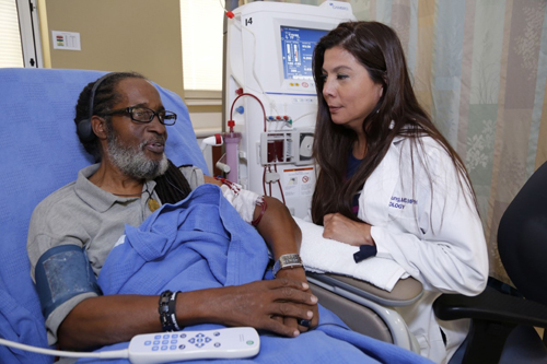 Adriana Hung, MD, MPH, talks with patient Sylvester Norman, who is participating in the VA Department's Million Veteran Program.