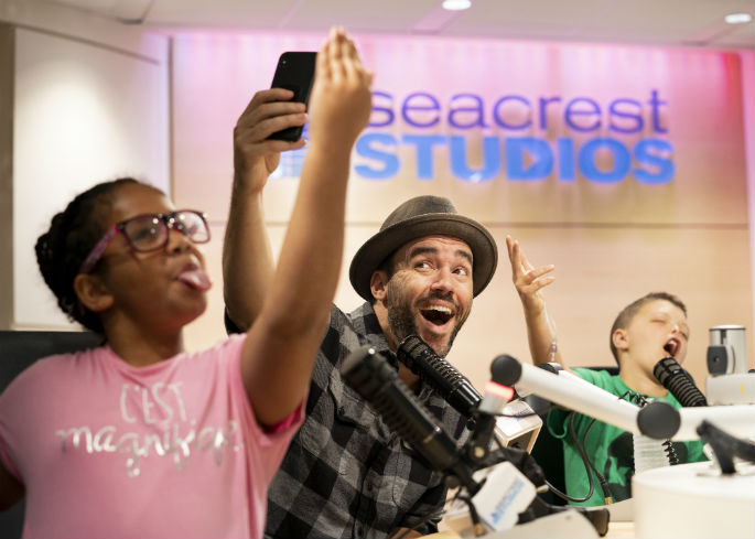 Celebrity photographer, Jeremy Cowart, hams it up with CeCe Townsend and Zaden Dill, during a visit to Seacrest Studio at Monroe Carell Jr. Children's Hospital on May 21.