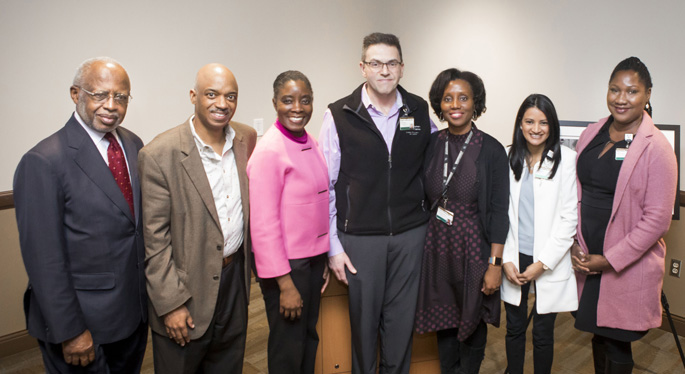 Friends, family and colleagues at the inaugural Dr. Harold Jordan Diversity and Inclusion Lecture included, from left, George C. Hill, PhD; Harold Jordan Jr.; lecturer Lloyda Williamson, MD; Ronald Cowan, MD, PhD; Terako Amison, MD; Reema Dedania, MD, MPH; and Ama Rowe, MD.