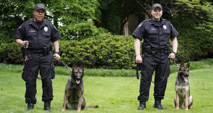 VUPD officer Sgt. Eddie Lawler and his K-9 companion Akali and Sgt. Joe Musick and Kato pose for a photo at VUMC.