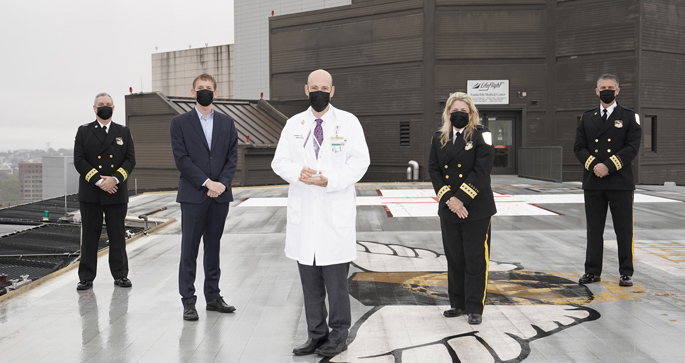 On the LifeFlight helipad are, from left, Kevin Nooner, MSN, RN, NE-BC, Airbus Helicopters' Romain Trapp, Stephan Russ, MD, Jeanne Yeatman, MBA, RN, EMT, MOM, and Michael Wallace, MBA, CCPM, NRP.