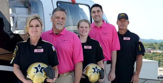 Vanderbilt LifeFlight's Marsha Roberts, Randy Hughes, Leah Smith, Kevin Mobley and Bric Baker show the pink flight name badges and shirts that LifeFlight staff will wear during the month of October. (Vanderbilt University)