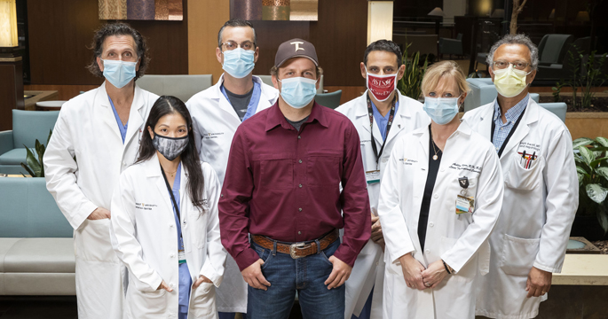 Liver transplant donor Sam Burnett with surgical team members, from left, Lee Gordon, MD, Lea Matsuoka, MD, Sophoclis Alexopoulos, MD, Martin Montenovo, MD, Ahlie Kerr, RN, and Joseph Awad, MD.