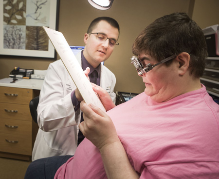 Joshua Robinson, OD, works with patient Melanie Oliver during a recent low-vision appointment.