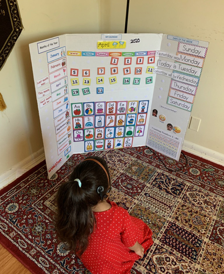 Students in the Mama Lere Hearing School have made their own at-home calendar boards to routinely discuss the days of the week, the weather and the day's schedule — all of which are typical discussions in their morning meeting with peers.