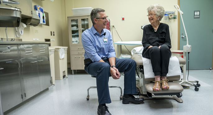 Timothy Geiger, MD, talks with Melba Martin, a patient in VUMC's new High-Risk Surgical Encounter Clinic.