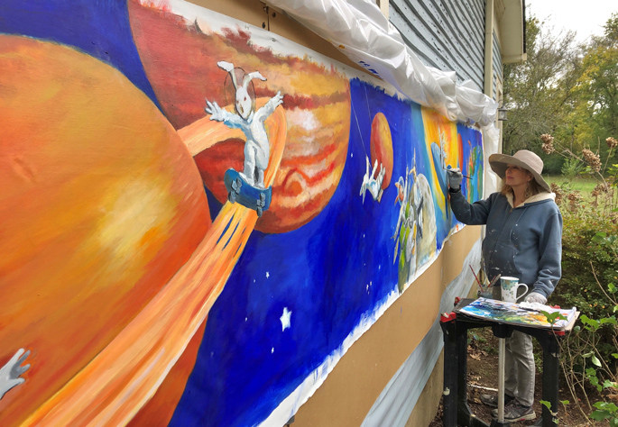 McCampbell works on the 22-foot long mural at her home in Franklin, Tennessee.
