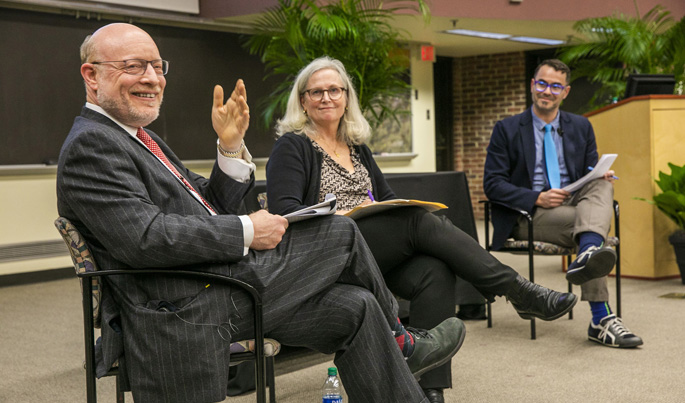 The health care proposal to provide Medicare for all was the focus of a panel discussion at the fall Research into Policy and Practice Lecture. Panel participants included, from left, Chip Kahn, Carol Paris, MD, and moderator Dan Gorenstein.