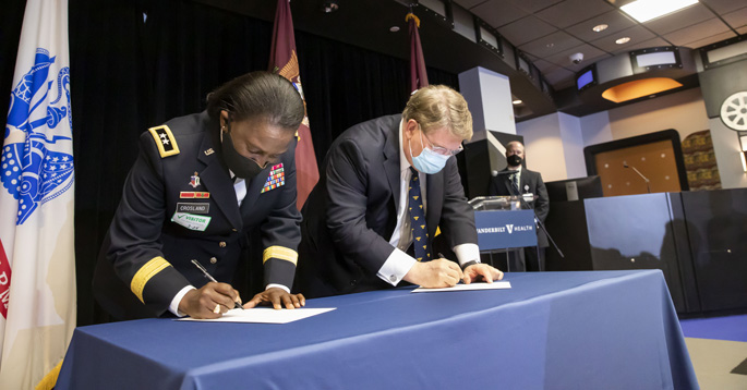 Maj. Gen. Telita Crosland and C. Wright Pinson, MBA, MD, sign the agreement for VUMC to become an official site of the U.S. Army Military-Civilian Trauma Team Training.
