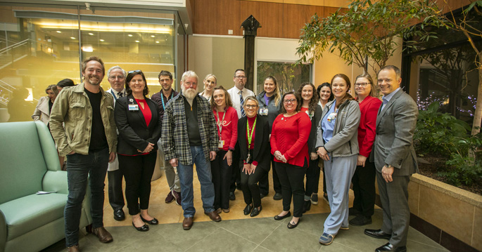 "Attendees gather at last week's dedication of ""The Gift of Life"" sculpture, which memorializes organ donors and their families and is on display in the Critical Care Tower."