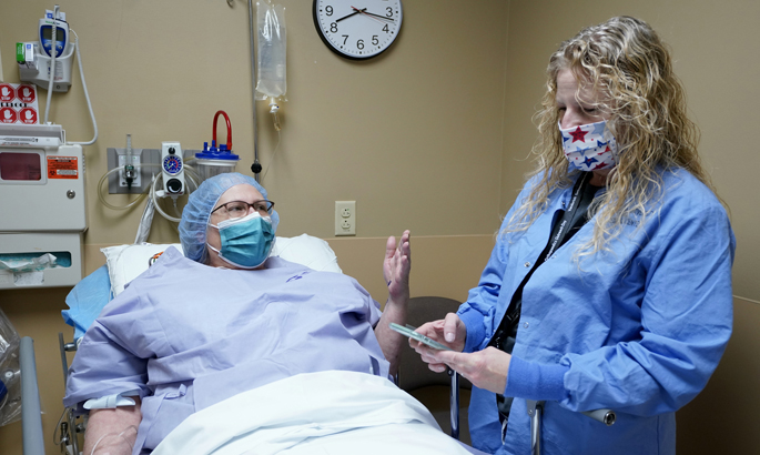 Barbara Beeson, RN, works with patient Cheryl Binford at last week's Vanderbilt Ortho-paedics Outreach Day.