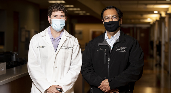 Christopher Hughes, MD, left, Pratik Pandharipande, MD, MSCI, and colleagues are studying two drugs recommended for patients receiving mechanical ventilation in the ICU.