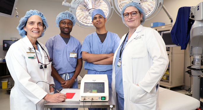 Carmen Solórzano, MD, left, Emmanuel Mannoh, Giju Thomas, PhD, Naira Baregamian, MD, and colleagues are testing a device to assist in locating parathyroid glands during surgery.